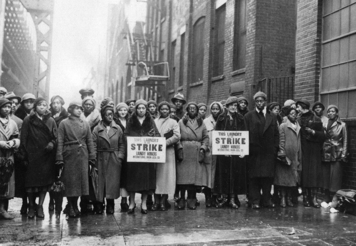 postcard caption: Historic Brooklyn Series #322. Local 135 workers on strike, picketing Colonial Laundry at Lexington and Grand Avenues. Clinton Hill, Brooklyn - 1934.