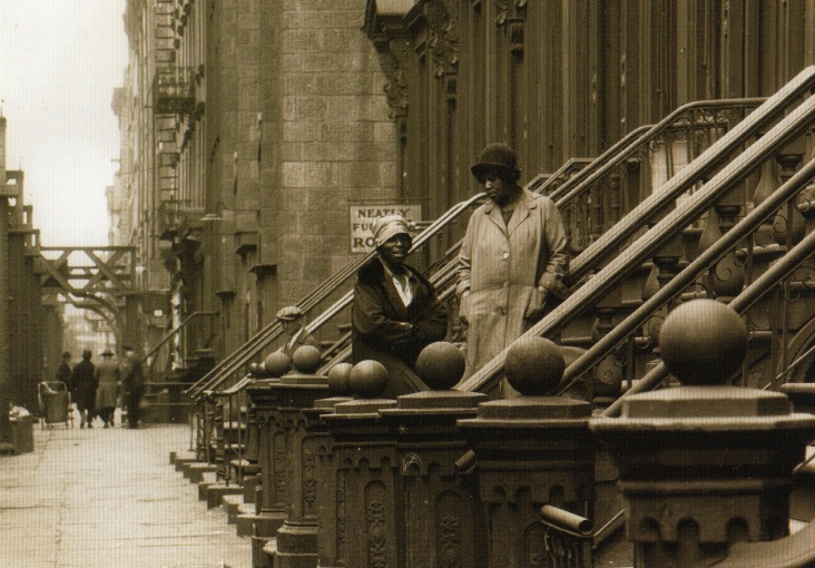 two women on a stoop. postcard caption reads: NYC Tenement Series #110. West 53rd St., Manhattan - 1927