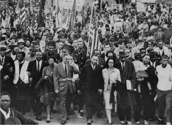 and the ultimate gem, looks to have been published in a magazine: March 25, 1965 - Montgomery, Alabama: Dr. Martin Luther King leads estimated 10,000 or more civil-rights marchers out on last leg of their Selma-to-Montgomery march. (UPI Photos).